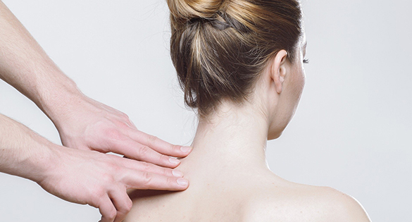 Rheumatologist checking a patient's back
